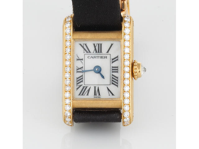 A diamond, mother-of-pearl and 18k gold tank wristwatch with satin strap, Cartier