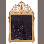 A Louis XVI giltwood mirror<br>fourth quarter 18th century