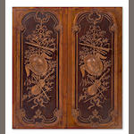 A pair of Louis XVI style trophy carved doors<br>late 20th century