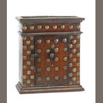 An Italian Baroque walnut and giltwood small table cabinet<br>late 17th century