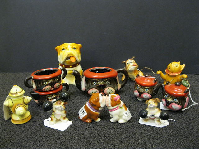 Nineteen sets of bulldog-form ceramic salt and pepper shakers, a bulldog-form covered jar with ladle, and a bulldog-form stacked tea set