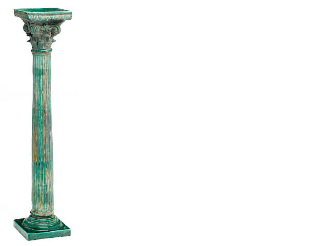 A Continental green glazed earthenware Corinthian column form pedestal