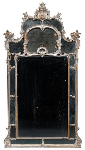 A good and imposing Italian Rococo carved silvered wood mirror  third quarter 18th century