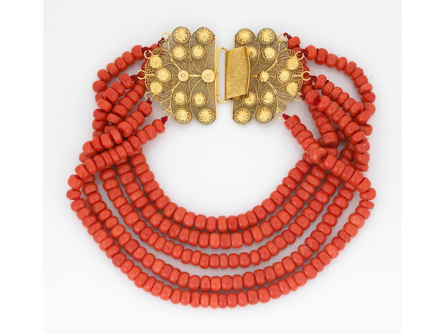 A five-strand coral bead necklace