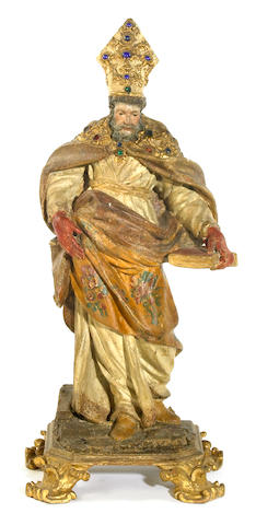 An Italian carved wood, polychrome decorated and 'jewel' mounted figure of Saint Augustine  late 17th/early 18th century