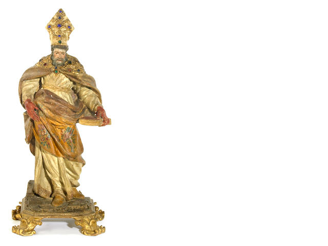 An Italian carved wood, polychrome decorated and jewel mounted figure of Saint Augustine <br>late 17th/early 18th century