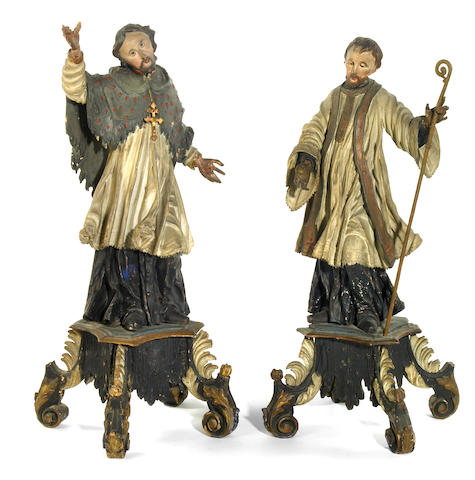 A pair of Austrian Baroque carved wood and polychrome decorated figures of Saints in rapture   18th century
