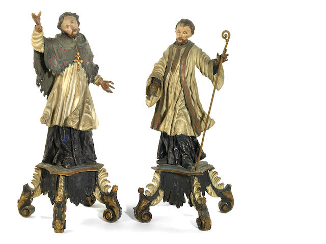 A pair of Austrian Baroque carved wood and polychrome decorated figures of Saints in rapture <br> 18th century