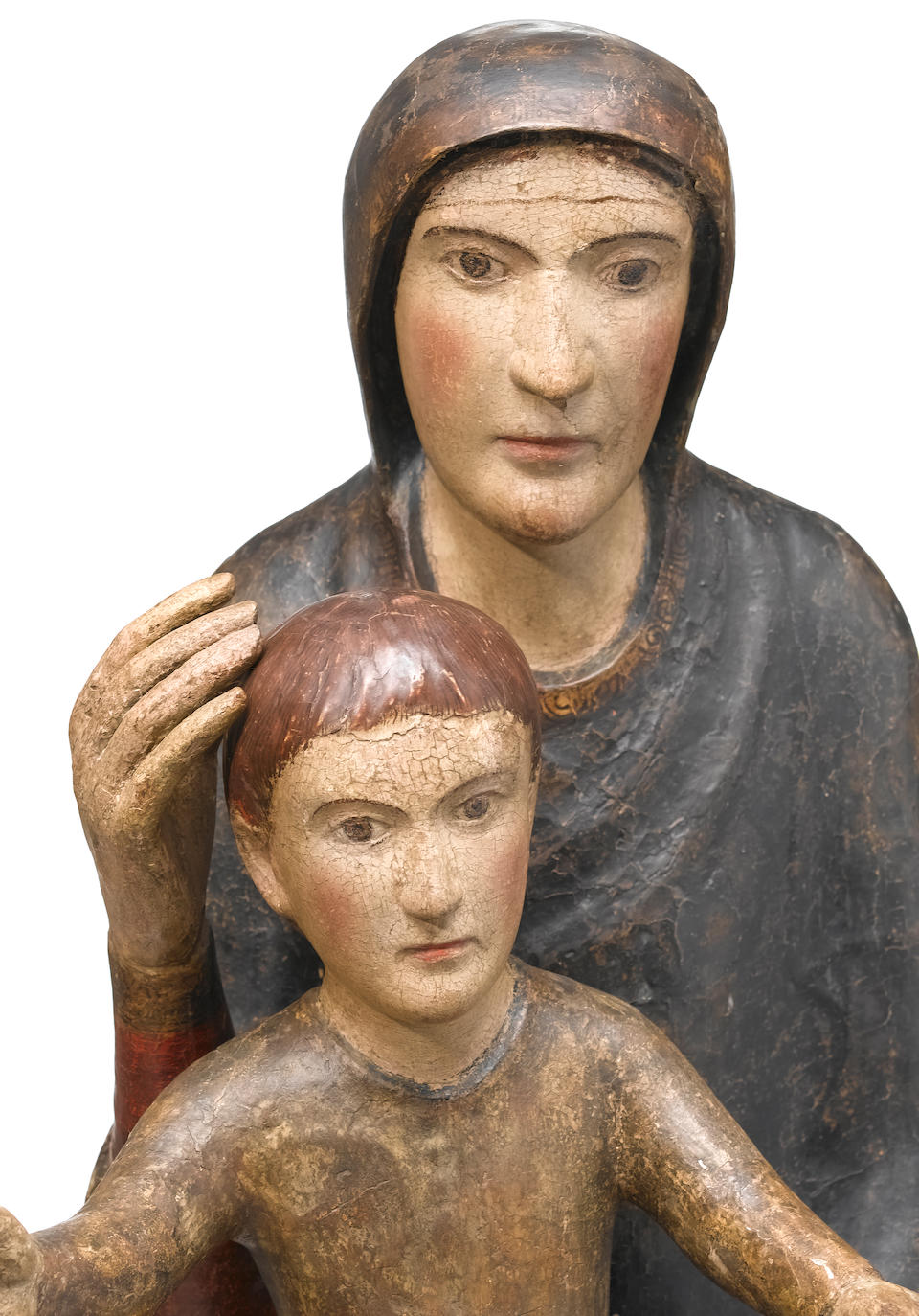 A Spanish Romanesque style carved wood and polychrome decorated figure of the Virgin and Child  probably 13th century, restored