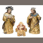 A group of three Spanish colonial polychrome decorated carved wood creche figures  <br>19th century