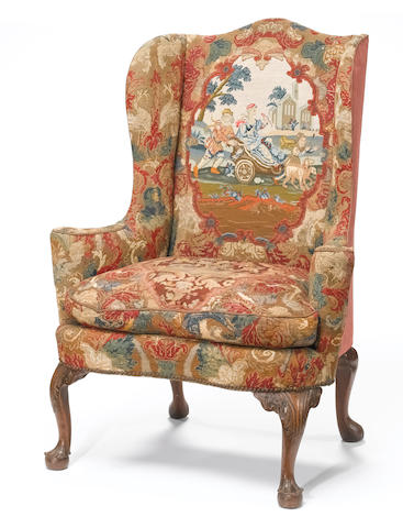 A George II carved walnut  wing armchair  second quarter 18th century