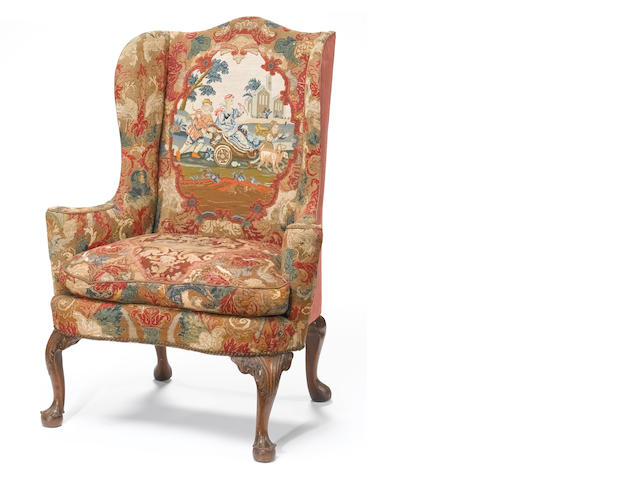A George II carved walnut  wing armchair <br>second quarter 18th century