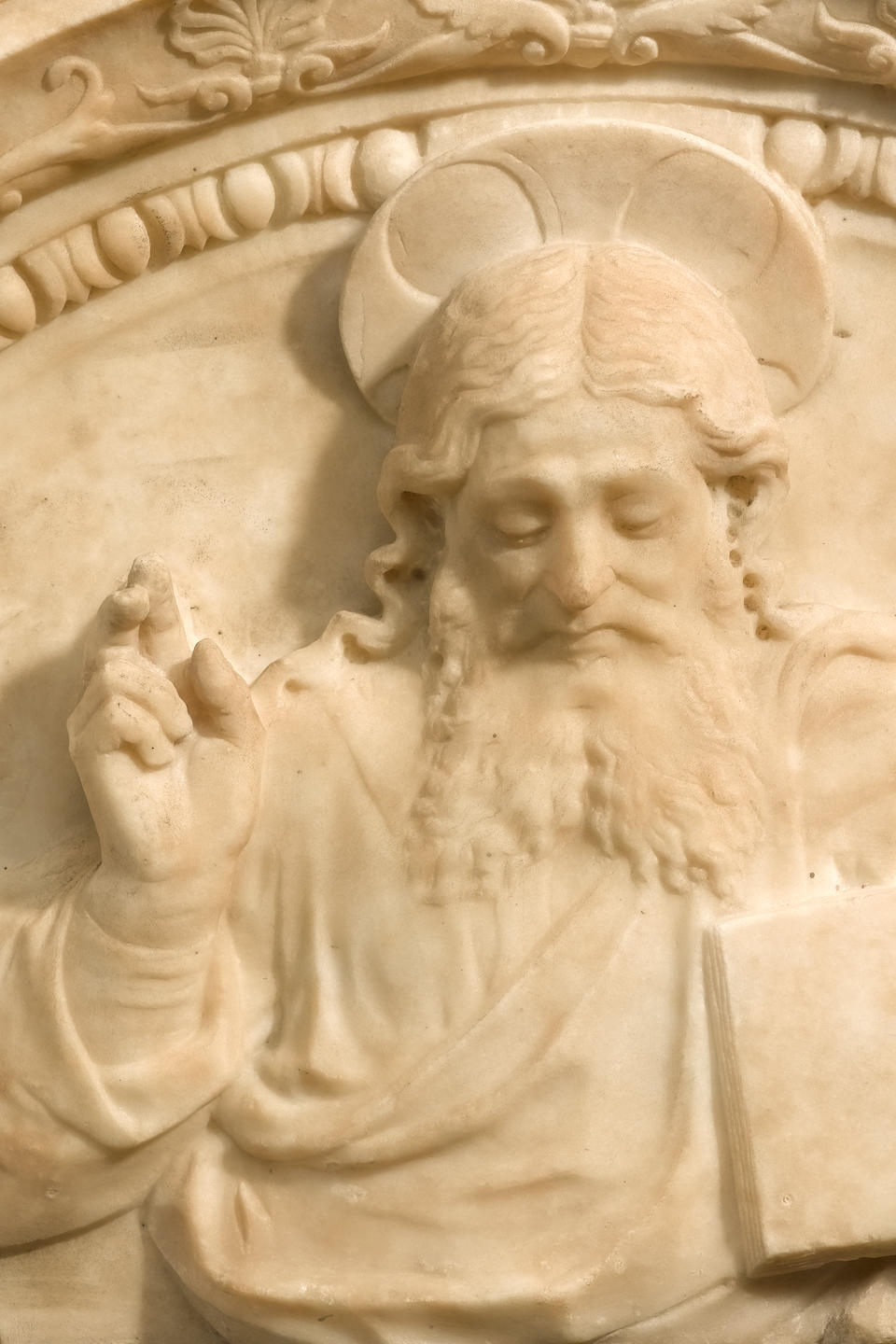 An important Florentine carved marble tympanum depicting God the Father  Style of Francesco de Simone Ferrucci (1437-1493) late 15th/early 16th century