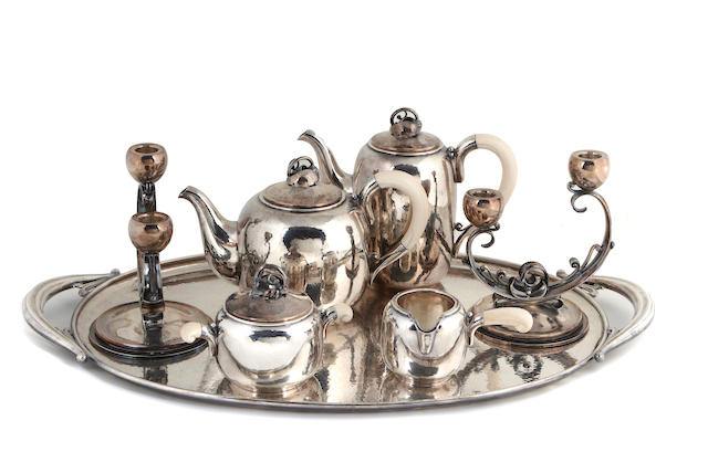 Danish sterling group: four piece tea and coffee set with ivory fittings and matching tray, with pair two-light candelabra, all by Holger Rasmussen
