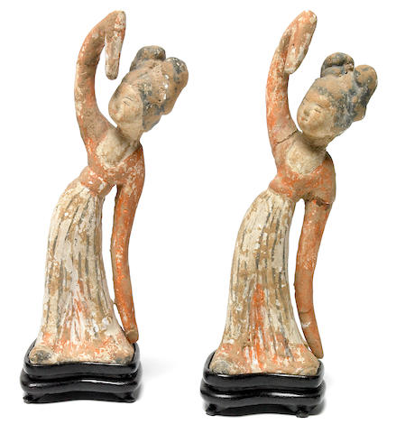 A pair of small Chinese painted pottery dancing maidens Tang Dynasty