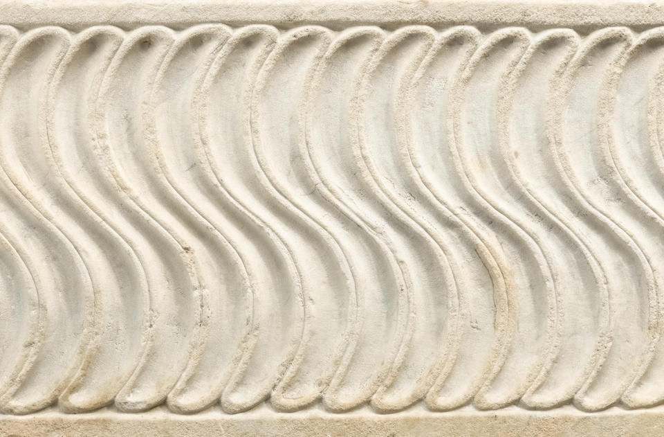 An Italian carved marble strigillated sarcophagus  after the antique early 16th century