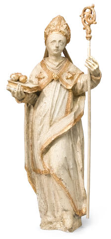 A Continental Baroque style carved wood, painted and gilt decorated figure of a Bishop