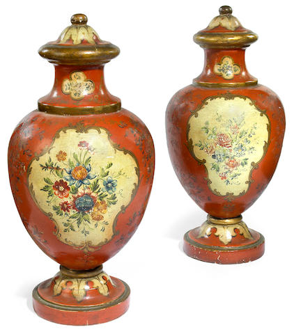 Two Continental paint decorated urns
