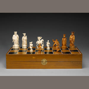 A carved ivory chess set with board 20th Century