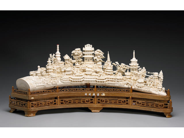 A massive carved and pieced ivory landscape tusk 20th Century