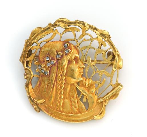 An art nouveau diamond and eighteen karat gold brooch, designed by Joe Descomps,