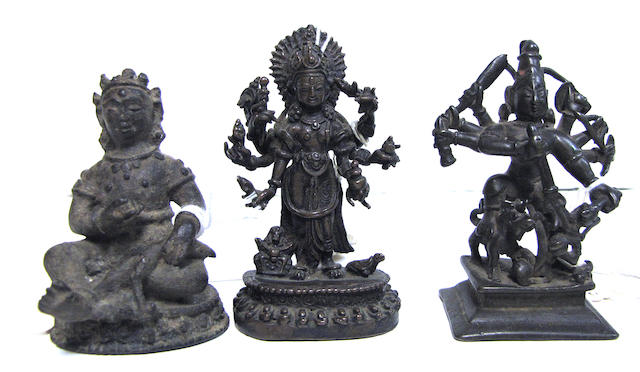 A group of three miniature cast bronze deities