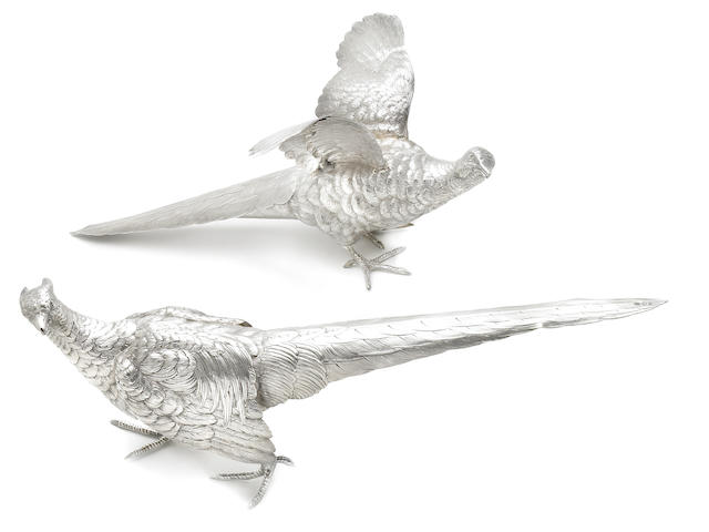 A continental silver pair of pheasant figures <br>Probably German, with psuedo hallmarks