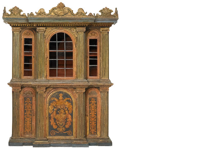 An Italian Baroque parcel gilt and paint decorated cabinet <br>incorporating antique and later elements