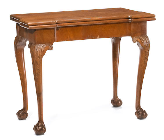 A George II walnut concertina action fold top games table <br>second quarter 18th century