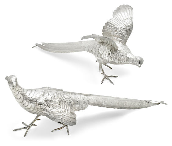A Continental silver pair of pheasant figures <br>Probably German, with pseudo hallmarks <br>Monogrammed on undersides: ESM