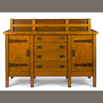 A Gustav Stickley oak eight legged sideboard