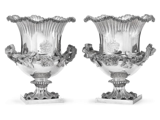 A Victorian silver pair of wine coolers with liners Reily & Storer, London, 1839 <br>With engraved full armorial on back and front and matching crest on interor parts