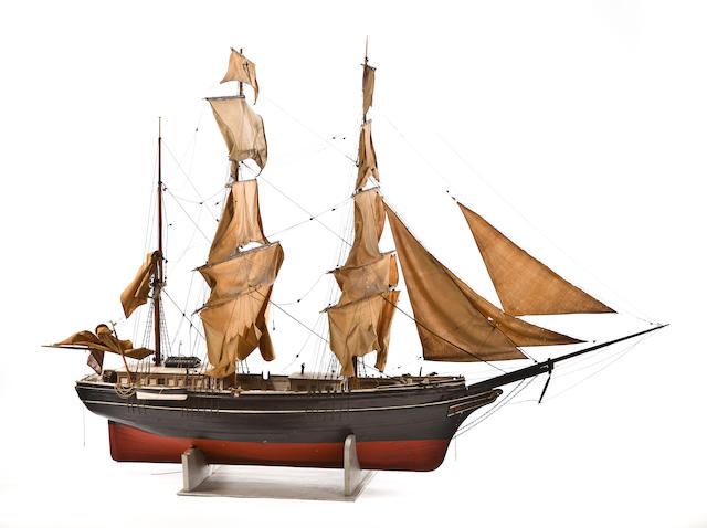 A large folk art model of an American three masted bark  late 19th or early 20th century 93 x 38 x 66-1/2 in. (236.2 x 96.5 x 168.9 cm.) model on cradle.