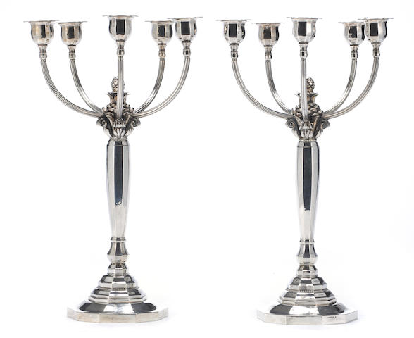 A Danish sterling pair of five light candelabra