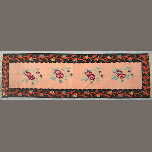 A Kilim size approximately 2ft. 10in. x 9ft. 8in.