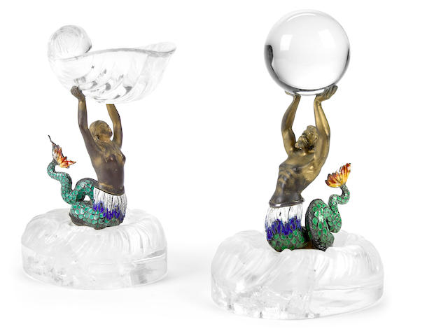 A pair of Continental silver gilt enamel and rock crystal figural tazze <br>late 19th/early 20th century