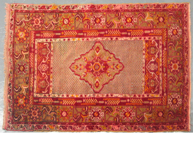 A Turkish rug size approximately 3ft. 4in. x 5ft. 4in.