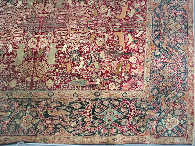 An Agra carpet size approximately 11ft. 4in. x 14ft. 4in.