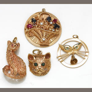 A collection of four gem-set, 14k and 18k pendants