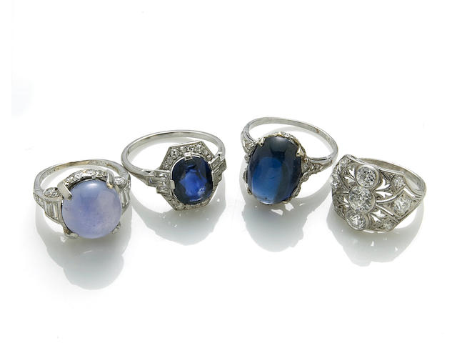A collection of four sapphire, diamond and platinum rings