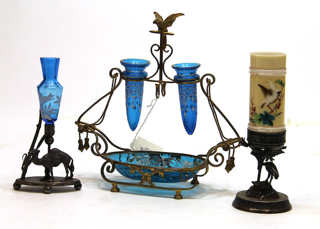 Three silver plated or gilt brass mounted colored and enamel glass items