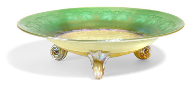A Tiffany Studios applied and intaglio carved Favrile glass footed bowl circa 1905