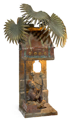 An Austrian cold painted bronze figural lamp of an Arab Harpist circa 1900
