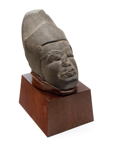 An unusual carved stone bust of a warrior