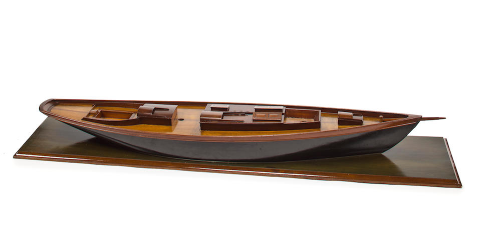 A naval architect's waterline presentation model of a schooner yacht  circa 1950 62 x 13-1/2 x 8-1/2 in. (157.4 x 34.2 x 21.5 cm.) model on baseboard.
