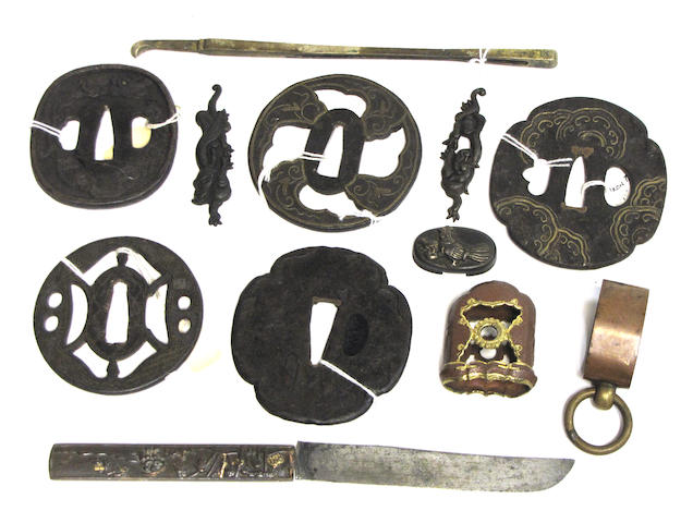 A group of Japanese metal sword fittings