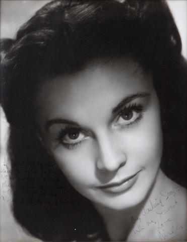 "A photograph of Vivien Leigh publicity shot of Vivien Leigh as Scarlett O'Hara from ""Gone With the Wind"", signed and inscribed to George Cukor."