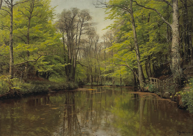 Peder Mork Mönsted (Danish, 1859-1941) A tranquil forest lake 32 1/2 x 46 1/4in (82.5 x 117.4cm)
