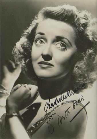 A photograph of Bette Davis  signed and inscribed to Charles Williamson