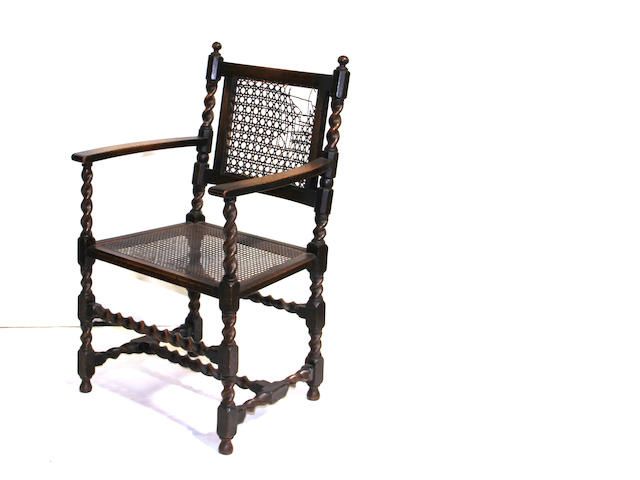 A Regency style oak armchair<br>mid 19th century
